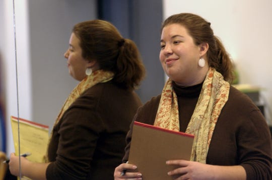 Erin Evarts smiles as she directs her actors with the Big Red Barn Players during a rehearsal in 2006.