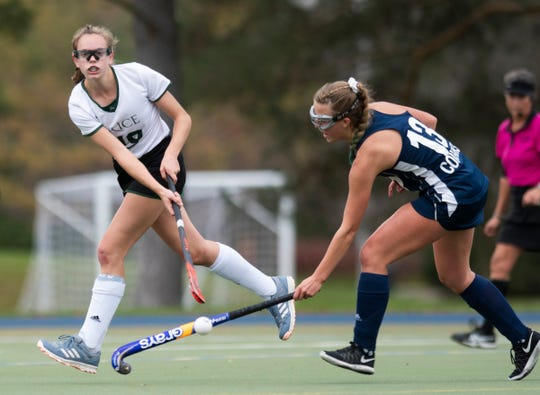 Rice's Amy Hester (19) hits the ball past MMU's Ava Stotz (13) during the field hockey semifinal game between the Mount Mansfield Cougars and the Rice Green Knights at Middlebury College on Wednesday afternoon October 30, 2019 in Middlebury, Vermont.
