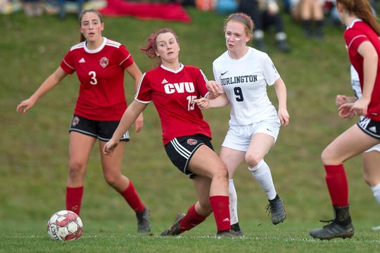 Champlain Valley's Olivia Morton (15) pressures Burlington's Helen Worden during a Division I high school girls soccer semifinal in Hinesburg on Wednesday, Oct. 30, 2019.