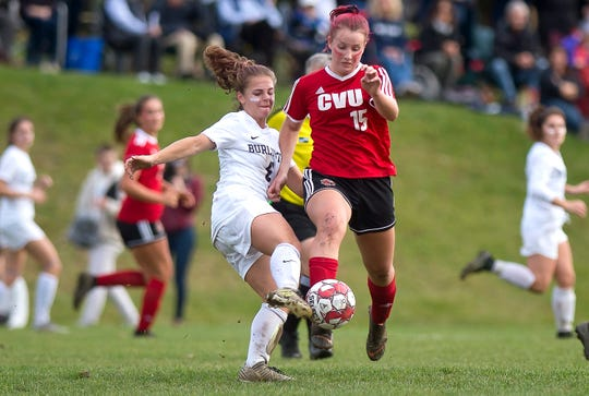 Burlington's Maggie Barlow, left, wins the ball away from Champlain Valley's Olivia Morton during a Division I high school girls soccer semifinal in Hinesburg on Wednesday, Oct. 30, 2019.