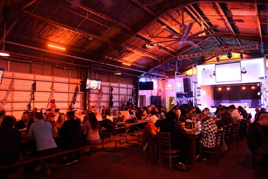 Fans watch the World Series at Brewster Street Ice House on Wednesday, Oct. 30, 2019.