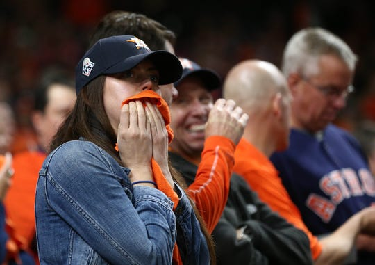 Oct 30, 2019; Houston, TX, USA; Houston Astros fans react during the eighth inning in game seven of the 2019 World Series against the Washington Nationals at Minute Maid Park. Mandatory Credit: Troy Taormina-USA TODAY Sports