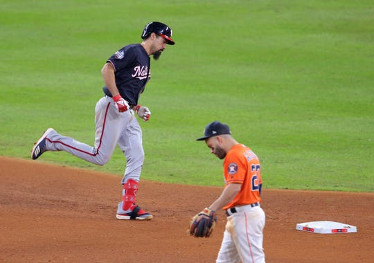 Oct 30, 2019; Houston, TX, USA; Washington Nationals third baseman Anthony Rendon (6) rounds the bases past Houston Astros second baseman Jose Altuve (27) after a solo home run during the seventh inning in game seven of the 2019 World Series at Minute Maid Park. Mandatory Credit: Erik Williams-USA TODAY Sports