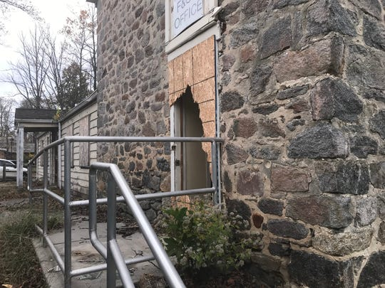 A doorway's been smashed open at an old stone building at the former Bancroft campus in Haddonfield.