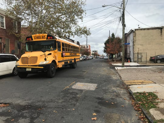 A school bus rolls down the 400 block of Pine Street in Camden, the former site of an open-air drug market.
