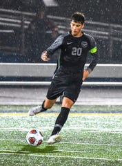 Ethan Seppi of Lakota East dribbles the ball against Elder at the OHSAA Division I, Region 4 semifinal, Monroe High School, Wednesday, Oct. 30, 2019.