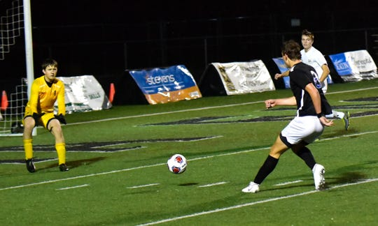 Jesse Levine's (8) shot on goal for a Wyoming score was all the Cowboys would need as they top Monroe 1-0 at the Division II boys soccer region semifinal, Oct. 30, 2019.