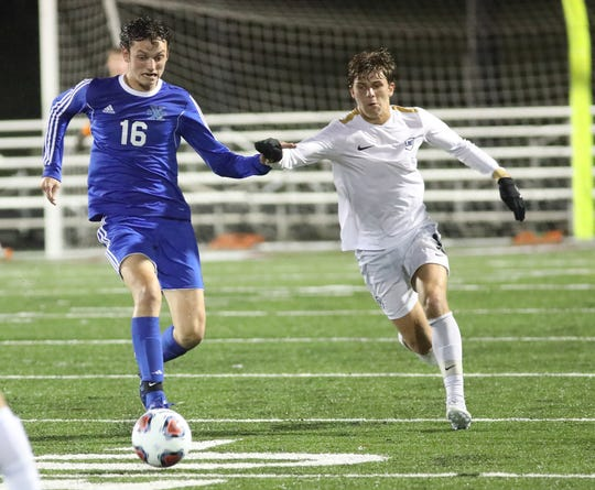 St. Xavier player Charles Bower (16) battles Moeller player Kade Tepe (9) during their regional semifinal Wednesday, Oct. 30, 2019.