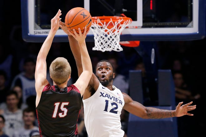 Indianapolis Greyhounds guard Frank Davidson (15) shoots over Xavier Musketeers forward Dontarius James (12) in the second half of the NCAA basketball exhibition game between the Xavier Musketeers and the Indianapolis Greyhounds at the Cintas Center in Cincinnati on Wednesday, Oct. 30, 2019. Xavier won the exhibition, 64-52.