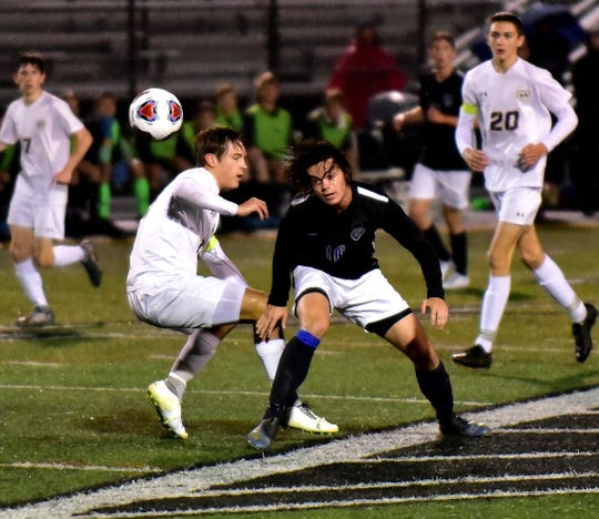 Jackson Marques (10) fires off a header pass for Wyoming at the Division II boys soccer region semifinal, Oct. 30, 2019.