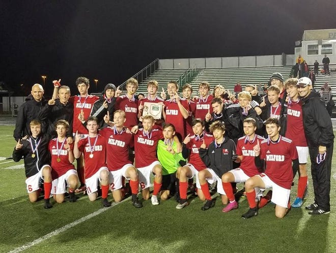 Milford boys soccer celebrates its first district championship since 2011 after defeating Springboro, 1-0, on Oct. 26, 2019 at Little Miami.
