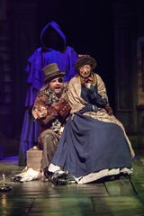 "Gregory Procaccino (left) plays a pair of scary characters in the Playhouse in the Park's production of ""A Christmas Carol."" Here, in a photo from the 2016 production, he is seen as Old Joe, a back-alley hustler buying stolen goods from Mrs. Dilber (Tatum Hunter)"