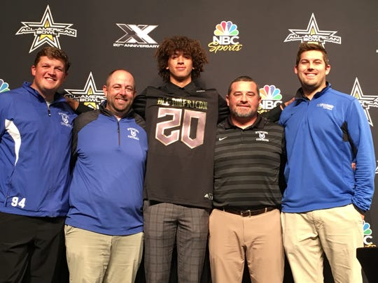 Wyoming senior quarterback Evan Prater (20) smiles with the Cowboys coaching staff Oct. 31. Prater will play in the U.S. Army All-American Bowl Jan. 4, 2020 in San Antonio