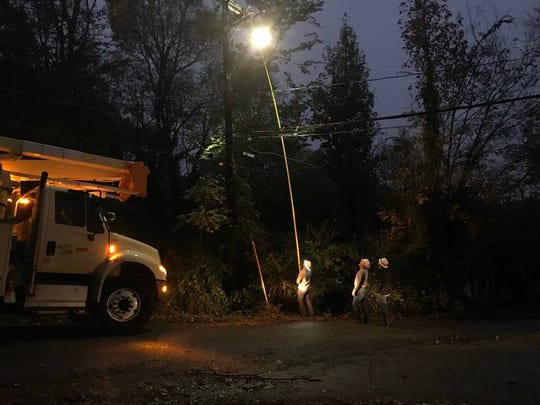 CDE Lightband crews work to restore power in a neighborhood off Fort Campbell Boulevard on Wednesday night, Oct. 30, 2019.