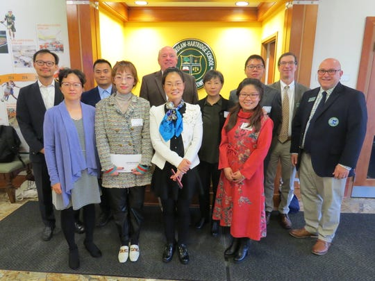The visiting teachers from Beijing gather for a group photo with Wardlaw+Hartridge administrators and teachers during their visit.