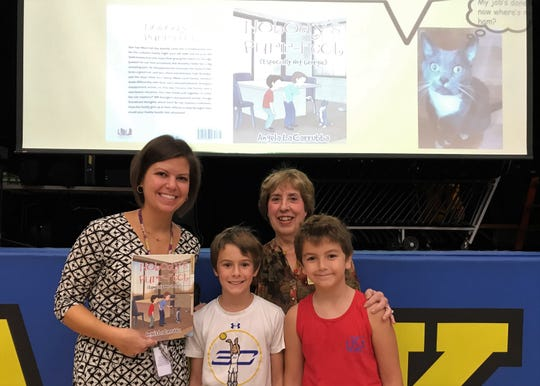 (From left) Franklin School librarian/media specialist Rachel Kennedy welcomes former Westfield teacher, now a children's author, Angela LaCarrubba on Monday, Oct. 7.  LaCarrubba is pictured here with her grandsons, fifth grader Kyle LaCarrubba (center) and second grader Kellen LaCarrubba.