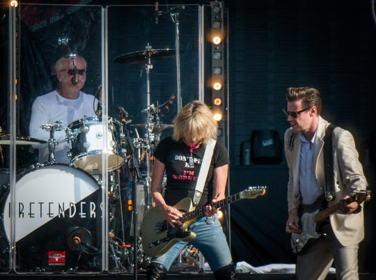 Martin Wilkinson, Chrissie Hynde and James Walbourne of The Pretenders perform at Comerica Park in Detroit on July 13, 2018.