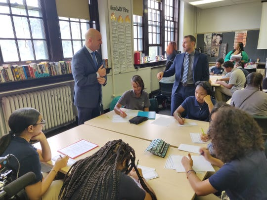 On the first day of school in September, Nir Saar, the principal at the School at Marygrove, talks to Superintendent Nikolai Vitti in a classroom. Saar is now on leave amid an investigation.
