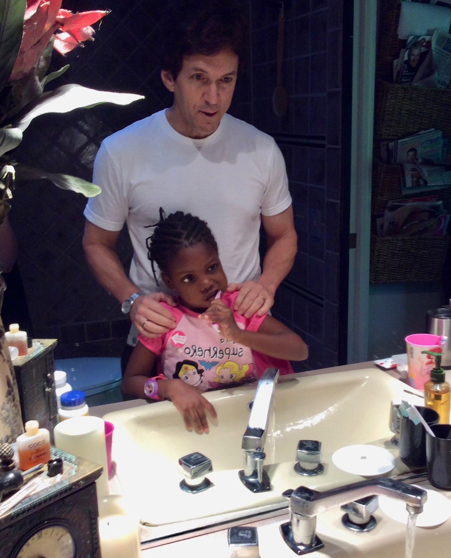 Chika, 5, and Mitch Albom during their daily morning and evening teeth brushing routine at the Alboms' home in July 2015.