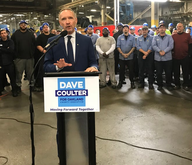 Former Ferndale mayor Dave Coulter stands last year inside a metal-working factory in Ferndale that had been vacant a decade ago, where Coulter declared his intention to run for the county executive job in 2020.