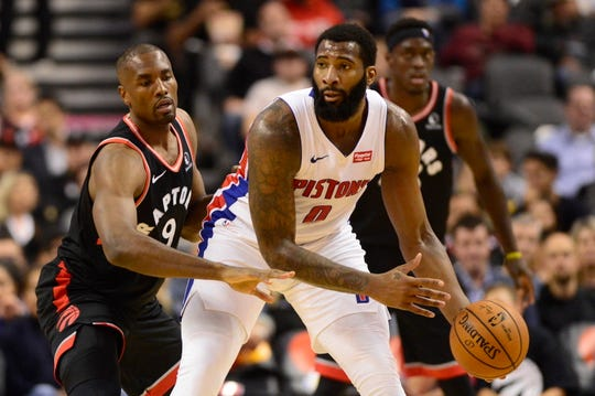 Detroit Pistons center Andre Drummond (0) controls the ball as Toronto Raptors forward Serge Ibaka (9) defends during the first half of an NBA basketball game, Wednesday, Oct. 30, 2019 in Toronto.