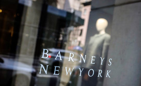 In this July 16, 2019, file photo signage for Barneys New York department store is displayed on the store's window in New York.