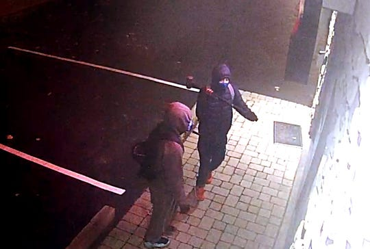 Keego Harbor police are looking for the two who broke into a gun shop Tuesday with a sledgehammer and stole several long guns and ammunition.