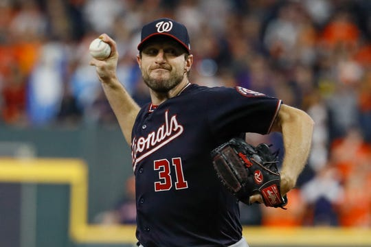 Washington Nationals starting pitcher Max Scherzer throws during the first inning of Game 7.