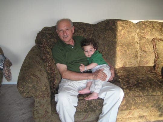Karim Khamarko with his grandson before his death in November 2010.