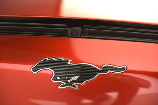 Mustang's familiar pony emblem is stretched horizontally and detailed — not with a horse's sinewy contours, but with a ribbed, techie surface. The logo on the GT performance model will be lighted in white.
