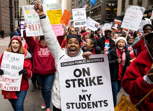 Thousands of striking Chicago Teachers Union members and their supporters march through the Loop, Thursday, Oct. 17, 2019, in Chicago.