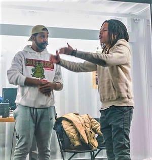 Music video producer Everett Stewart , left, with rapper Domani Harris.