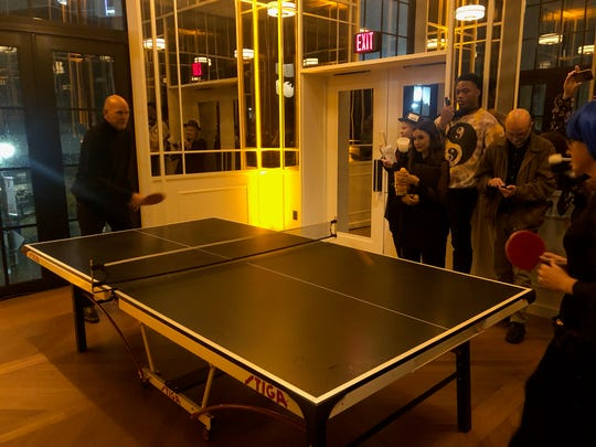 Kirk Gibson plays ping pong with an auction winner at a fundraiser Wednesday for his Parkinson's foundation in Detroit.