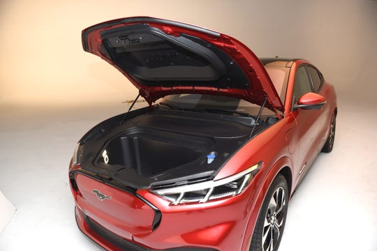 "Storage space in the ""frunk"" of the Mustang Mach-E is big enough for a carry-on bag, but could also be filled with ice for tailgating."