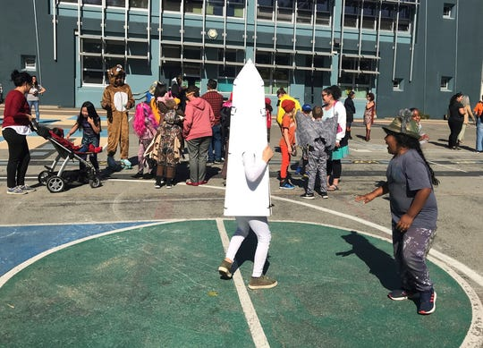 Children at Washington Elementary in Berkeley, Calif., play during the school's annual Halloween costume parade outside on Thursday, Oct. 31, 2019. The school had considered holding the parade indoors if the air quality was questionable because of a massive wildfire in Northern California's wine country.