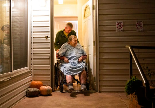 Henry Provencher, 87, is wheeled out of Redwood Retreats, a residential care facility by owner Eric Moessing while evacuating due to the Kincade Fire in Santa Rosa, Calif., on Saturday, Oct. 26, 2019.