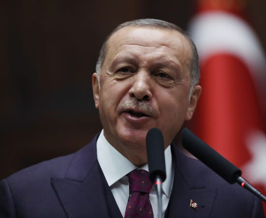 Turkish President Recep Tayyip Erdogan addresses his ruling party legislators at the Parliament, in Ankara, Wednesday, Oct. 30, 2019. Erdogan says joint patrols with Russia will begin Friday in northeastern Syria, following a Russian-brokered cease-fire that promised to have Syrian Kurdish forces withdraw to the south.