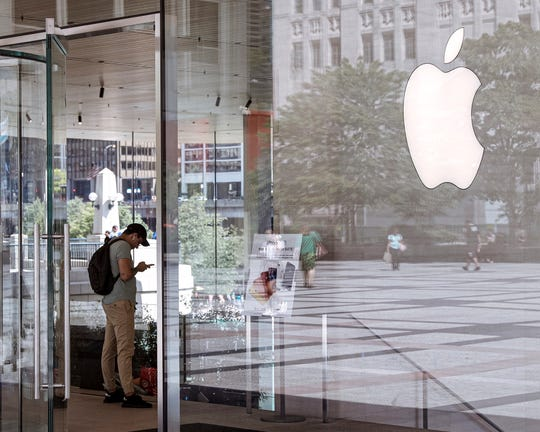 FILE - This July 24, 2019, file photo shows an Apple Store in Chicago is seen. Apple Inc. reports financial earns on Wednesday, Oct. 30.