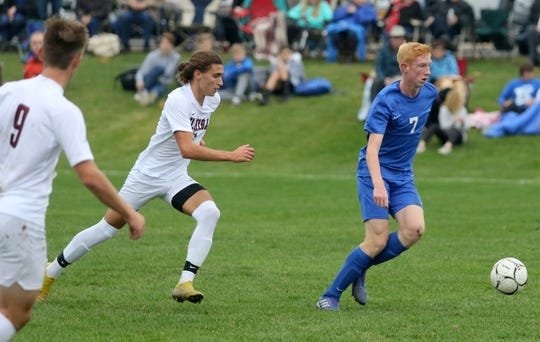 Carter McCreary of Horseheads kicks the ball ahead as Elmira's Cameron Kelly-Hobbs gives chase during a Section 4 Class AA boys soccer semifinal Oct. 30, 2019 at Horseheads High School.