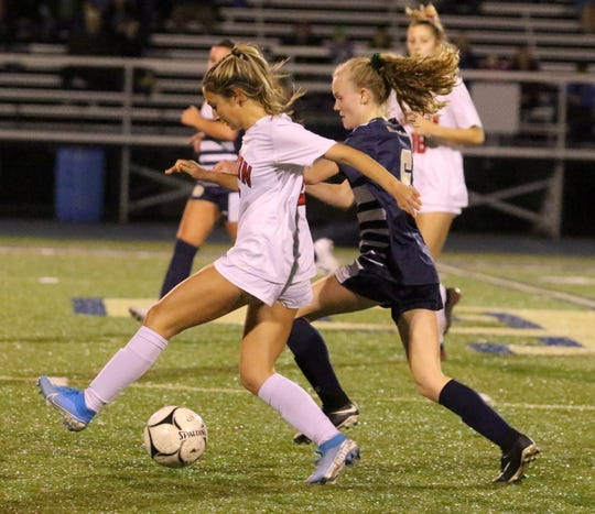 Groton's Natalia Bell (10) and Elmira Notre Dame's Rachel Simpson battle for possession during a Section 4 Class C girls soccer semifinal Oct. 30, 2019 at Notre Dame.