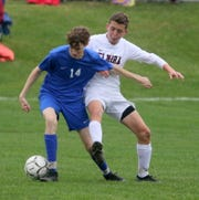 Chris Gibbons of Horseheads controls the ball as Elmira's Joe Bruner defends during a Section 4 Class AA boys soccer semifinal Oct. 30, 2019 at Horseheads High School.