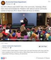 Officer Mario Reid reading to children at Carver Community Center.