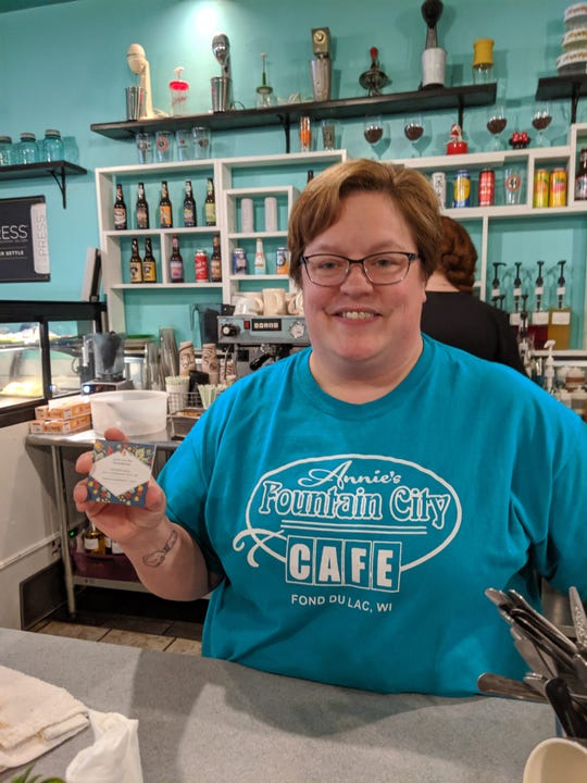 Annie Culver from Annie's Fountain City Cafe' with one of the Fondy Nice  cards that can be used to pay it forward.
