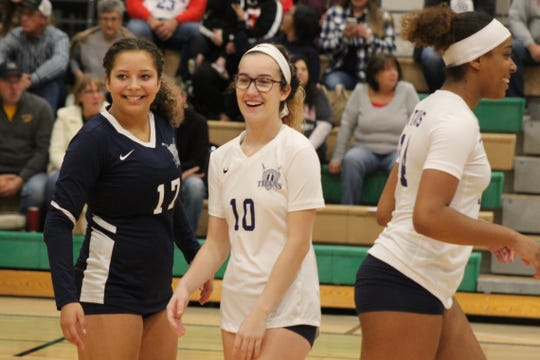 Terra State Community College volleyball players Baleigh Robinson, pictured left, Delaney Cochran and Jakyla Jackson share a laugh Wednesday during the Titans' final match of the year against the University of Rio Grande JV squad. The Titans won the match 25-10, 25-15, 25-16.