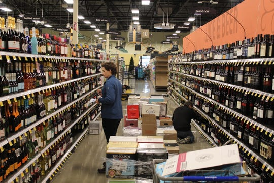 Work continued Thursday on stocking shelves at the new Kroger store on Cedar Street. The store opens Wednesday at 8 a.m.