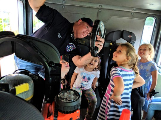 Bataan kindergarten students Piper Mominee, Nayleea Arnold, Addilyn Hildreth and Kahlie Blohm are amazed by the heat sensor demonstrated by PC Firefighter Rob Ward.