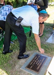 "Best friend, Bert Seidman, Fort Myers, places a stone on the head stone of Martin Posnansky. The stone is a symbol that someone was there. ""Flowers fade and die, a stone is a symbol of strength,"" Rabbi Nicole Luna from Temple Beth El in South Fort Myers explained.  Martin Posnansky, a Vietnam vet, died in 2006 and never had a headstone because he had no family. His best friend, Bert Seidman, Fort Myers, tried for years to get a headstone placed. Through the Cape Coral group, Hearts for Homes, Posnansky got a headstone. They dedicated it at a ceremony, Thursday, October 31, 2019, at Coral Ridge Cemetery in Cape Coral."