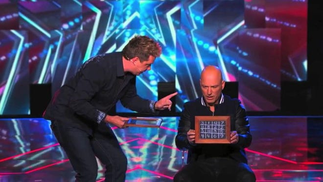 "Magician and illusionist Mike Super, left,  performs a trick for ""America's Got Talent"" judge Howie Mandel during the show's ninth season, during which he became a finalist. Super will perform Jan. 25, 2020, at the Southern Door Community Auditorium."