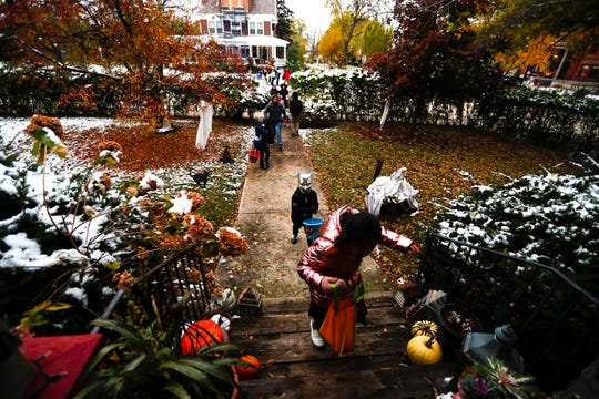 Trick-or-treaters visit Astor House in Green Bay.