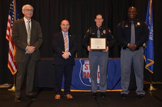 State Patrol Sergeant Jennifer Austin receives her Lifesaving Award at the 2019 State Patrol Awards.